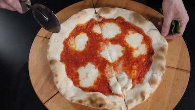 Top View of Cutting Pizza with Round Cutter Knife