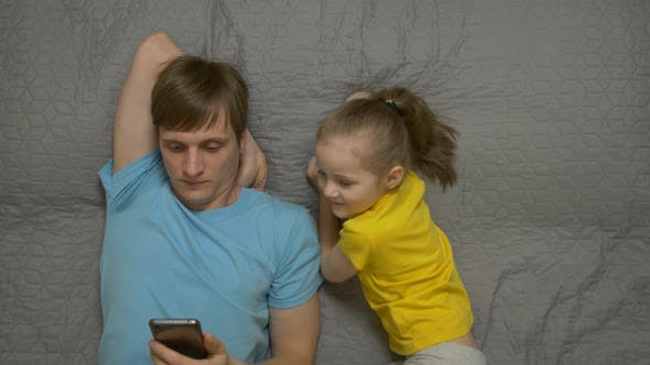 Thumbnail for Father With Phone Daughter