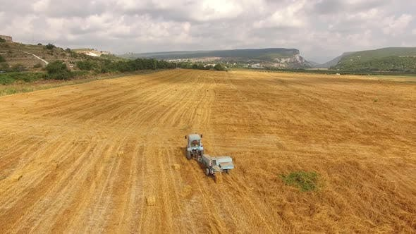 Thumbnail for Tractor Rides in the Field with the Harvested Crop Bird's-eye