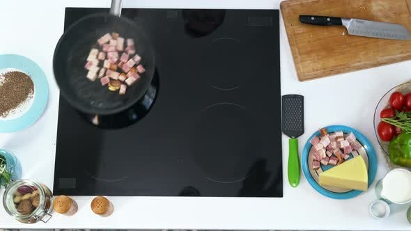 Thumbnail for Cook Frying Garlic and Bacon