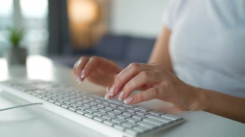 Female Hands Typing on a Computer Keyboard