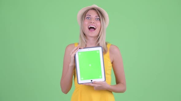 Thumbnail for Happy Young Blonde Tourist Woman Talking While Showing Digital Tablet