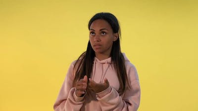 Goodlooking Black Woman Counting Something on Fingers