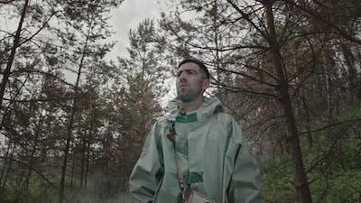 Man in Hazmat Suit in Radioactive Forest