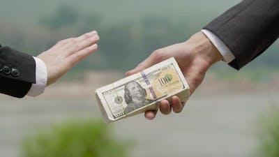 Businessman Refusing Money