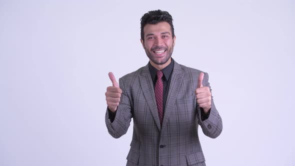 Thumbnail for Happy Bearded Persian Businessman Giving Thumbs Up and Looking Excited