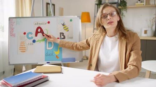 Primary School Teacher Teaching Online Class