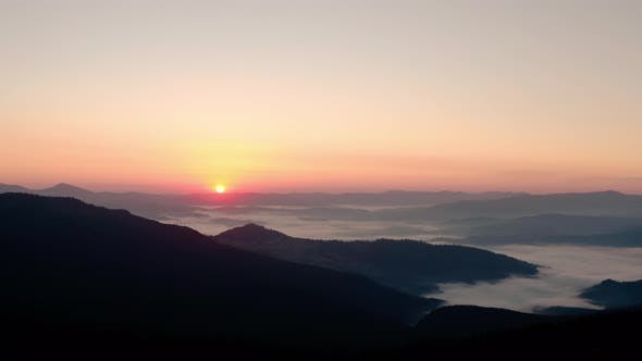 Thumbnail for Aerial Drone View, Sunrise or Sunset in the Mountains, Flying Over the Trees in the Sun