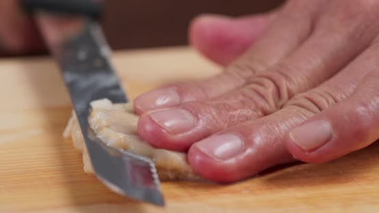 Thumbnail for Cutting Fresh Geoduck on wooden board