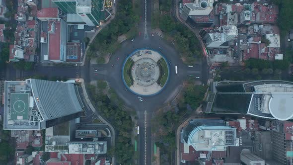 Overhead Top Down Aerial View of Roundabout Around The Angel of Independence Monument in Urban City
