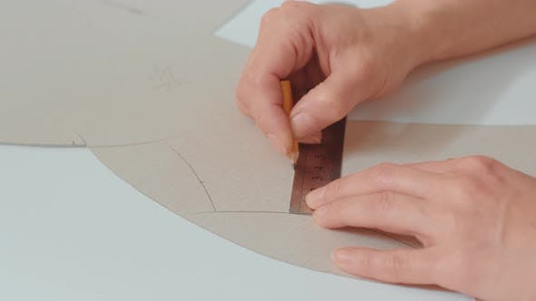 Female fashion designer working on her designs in the studio. Fashion designer