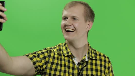 Thumbnail for Caucasian Young Man in Yellow Shirt Taking Nice Selfies on the Smartphone