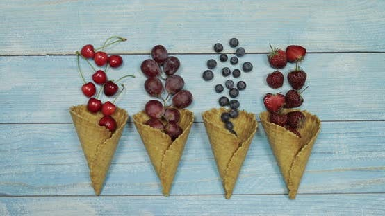 Thumbnail for Berry and Fruit Ice Cream. Blueberry, Strawberry, Cherry, Grape in a Waffle