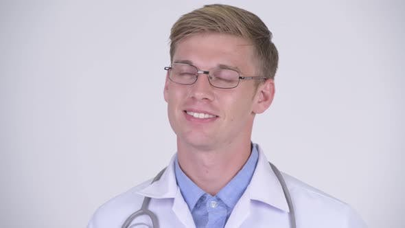 Thumbnail for Face of Happy Young Handsome Man Doctor with Eyeglasses Thinking
