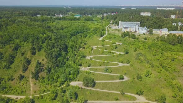 Thumbnail for Hairpin Curves of Path on Beautiful Green Hill Aerial View