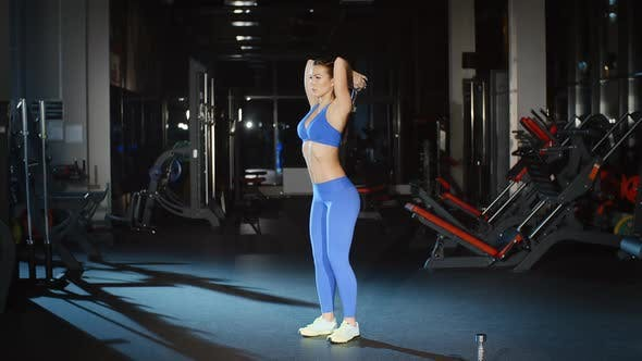 Thumbnail for Female Athlete in Sportswear Working Out and Training Her Arms and Shoulders With Dumbbell in Gym