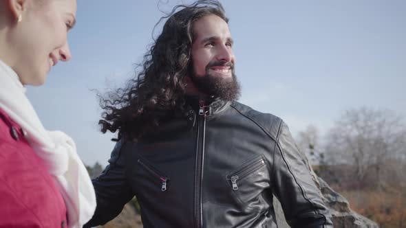 Thumbnail for Close-up of Young Bearded Middle Eastern Man with Long Curly Hair Standing in Autumn Park and