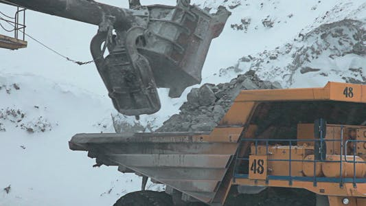 Thumbnail for Dump Truck Loaded With An Excavator