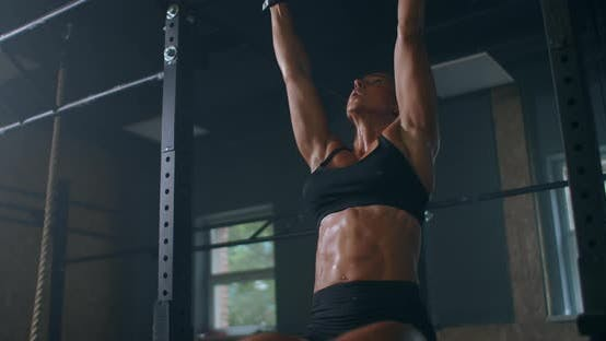 Thumbnail for Slow Motion: Raising Feet Up To Bar on Gym Bar, Attractive Muscle Woman Exercise and Train in Gym