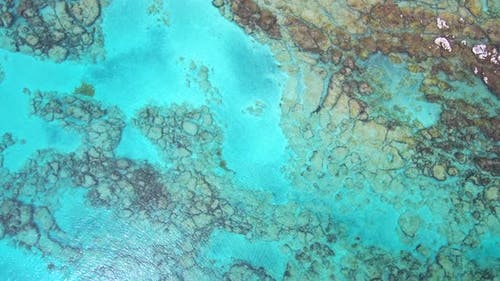 Aerial footage of beautiful coral reefs in turquoise color water