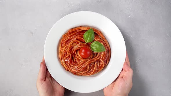 Thumbnail for Woman's Hands Placing Plate with Spaghetti on a Table