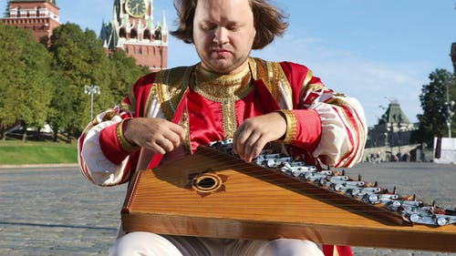Minstrel With Music Instrument Gusli