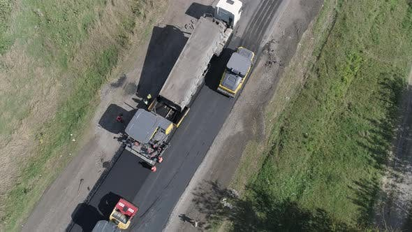 Thumbnail for Aerial of trucks on a road under construction