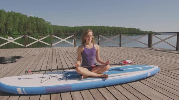 Thumbnail for Practicing Yoga at Lake Pier