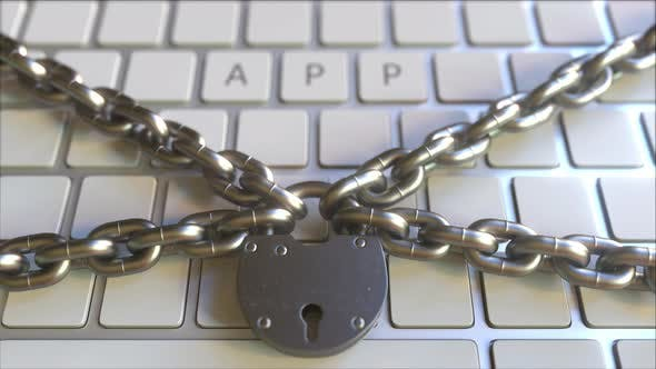 Thumbnail for APP Text on the Keys of a Keyboard with Padlock and Chains
