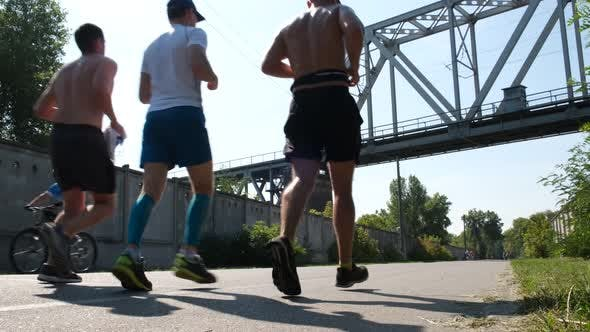 Thumbnail for Three Unrecognizable Runners Jogging in the Park. Active Sport Concept