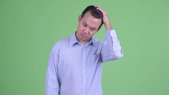 Thumbnail for Stressed Asian Businessman Having Headache