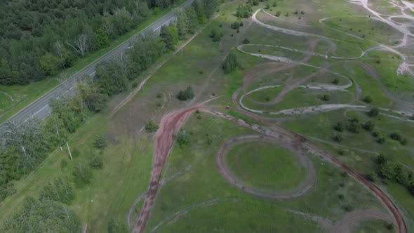 Thumbnail for Aerial view of motorcycle race track with motorbike training for race track on a dirt cross circuit