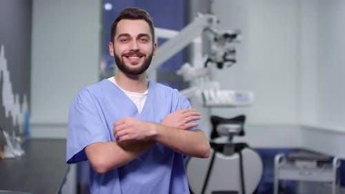 Happy Dentist in Scrubs Posing