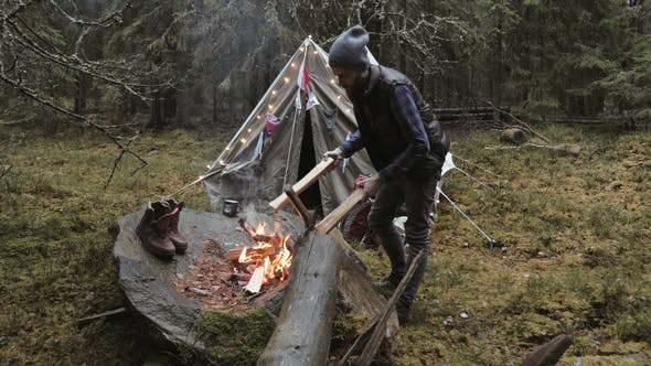 Thumbnail for Adventurer Making Campfire by the Tent While Forest Camping