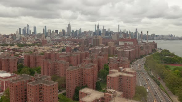 Thumbnail for Flight Over Freeway with Car Traffic, New York City Skyline with Cloudy Sky