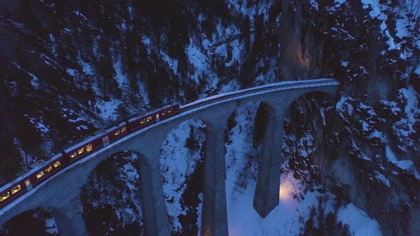 Landwasser Viaduct with Railway and Train at Winter Evening