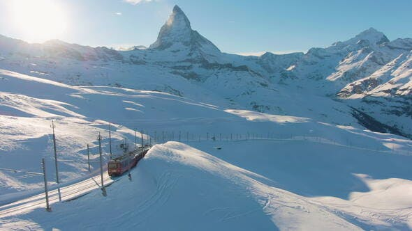 Thumbnail for Matterhorn Mountain and Gornergrat Train in Winter at Sunset. Swiss Alps. Switzerland. Aerial View