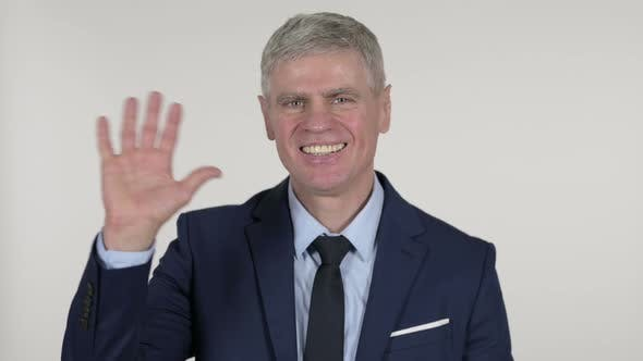 Thumbnail for Senior Businessman Waving Hand To Welcome on White Background