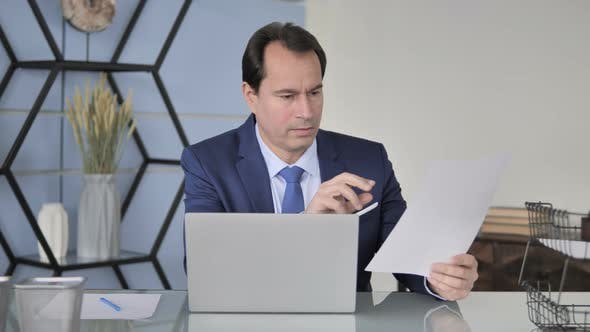 Thumbnail for Businessman Working in Office, Paperwork