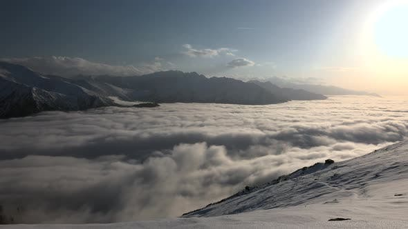 Thumbnail for Sunsets Over The Clouds On Snowy Mountains
