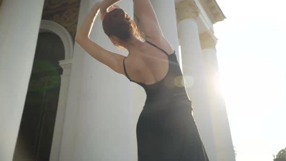 Back View of Slim Young Woman Dancing Ballet in Sunbeam
