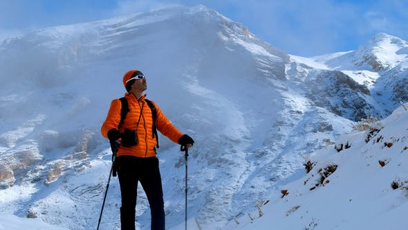 Cover Image for Hiker Man On Foggy Snowy Mountain
