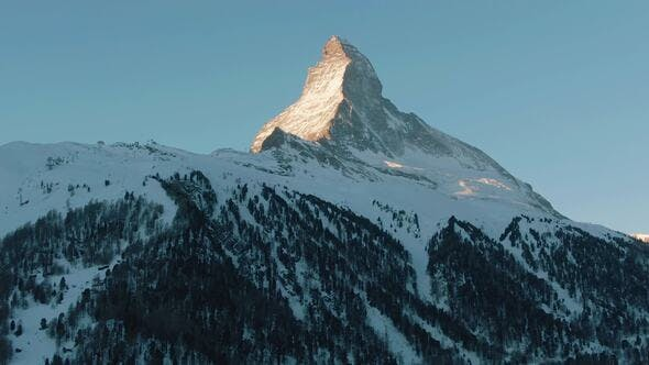 Thumbnail for Matterhorn Mountain and Forest in Winter Morning, Swiss Alps