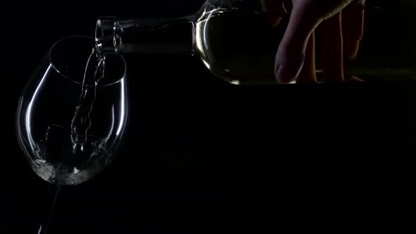 Thumbnail for White Wine Being Poured Into a Wine Glass, Silhouette, Black , Slowmotion