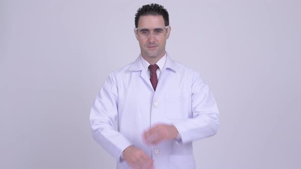 Thumbnail for Happy Handsome Man Doctor with Protective Glasses Smiling with Arms Crossed