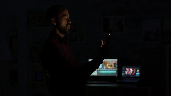 Young Man Giving a Voice Command To a Smart Light App