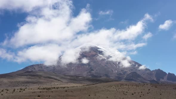 Thumbnail for Aerial view revealing the whole chimborazo vulcano from behind a hill while flying closer towards it