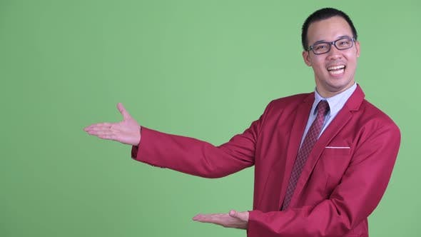 Thumbnail for Happy Asian Businessman with Eyeglasses Showing Something