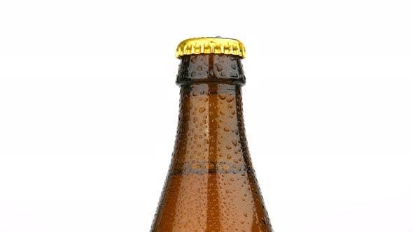 Thumbnail for Brown beer bottle rotating over white