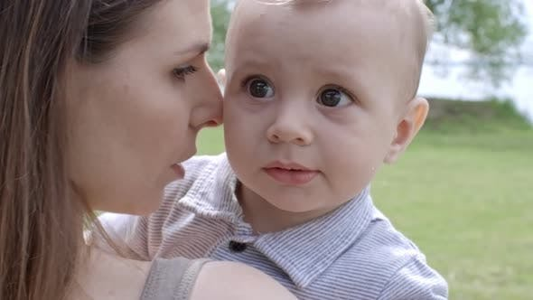Thumbnail for Mother Holding Curious Little Boy